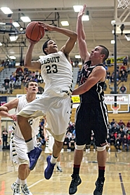 by: Miles Vance GOING UP —  Jesuit sophomore wing Franklin Porter (left) goes to the basket while defended by North Salem's Justin Lowe during the Crusaders' 81-46 win over the Vikings on Tuesday in the first round of the Les Schwab Invitational at Liberty High School.