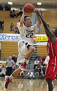 by: Miles Vance GOING UP — Southridge's Caleb Herzberg goes up for a layup against Riverside during his team's first-round loss in the Les Schwab Invitational on Monday.