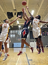 by: Miles Vance SKY HIGH — Westview junior Jaime Nared (center) leaps with Central Catholic's Kailee Johnson and Jordan Reynolds during Westview's Tuesday win.