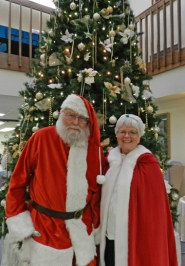 by: Noelle Bledy RINGING IN THE HOLIDAYS — Santa (aka  King City Lions Club member Jim Moonier) and Mrs. Claus (aka Venice Graff, Pacific Pointe's activity director) strike a pose at the annual Christmas brunch.