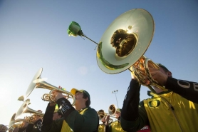 by: CHRISTOPHER ONSTOTT The University of Oregon band plays at Sunday's pep rally in Santa Monica, Calif., on the eve of the 98th Rose Bowl.