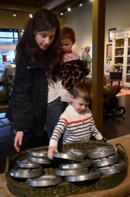 by: VERN UYETAKE Sarah Culp shops at Sofa Table Chair in West Linn with Maclain, 4, and Cecilia, 2.