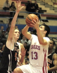 by: David Ball Centennial's Max Campbell drives to the basket on Tuesday night.