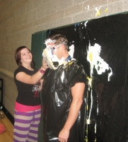 by: Barbara Sherman Laurel Ridge Middle School student Katelynn Adams fires a pie into the face of Principal Steve Emmert, a reward for raising the most money to help pay tuition for students in Haiti.