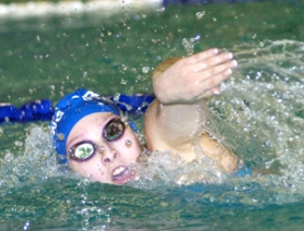 by: David Ball Nicole Kemp makes a stroke during Gresham's win in the 400-yard freestyle relay to end Thursday's dual win over Barlow.