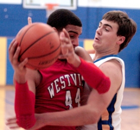by: David Ball Barlow center Cody Powers, right, blocks Westview's Landen Lucas from the basket during the Wildcats 45-39 win on Friday night. Lucas, a Kansas University recruit, was held to only two baskets in the second half.