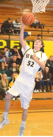 by: John Brewington BIG QUARTER—St. Helens' Brandon Underwood had 18 of his game-high 29 points in the fourth period during Friday's game with Milwaukie.
