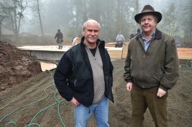 by: VERN UYETAKE From left, Gerald Rowlett with Westlake Development Group and homeowner Jerry Kitchen visit the site of Kitchen's new home on Bonaire Avenue in Lake Oswego.