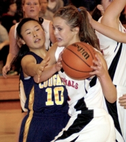 by: David Ball Corbett's Emma Peterson drives around Cougars defender Hannah Kim on Thursday.