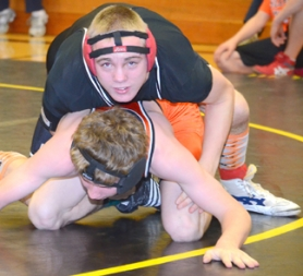 by: John Brewington UNDEFEATED—Scappoose wrestler Chris Wagner (one top) hasn't lost a match this year and has his sights set on another state title.