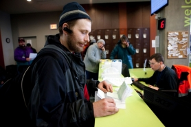 by: CHRISTOPHER ONSTOTT Glenn Cooperider works with Transition Projects Inc. staff to obtain a temporary ID card at the Bud Clark Commons day resource center. Cooperider has been homeless for two weeks and thanks to the center, is already on a waiting list for housing.