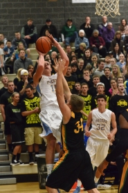 by: VERN UYETAKE Brandon Loiler puts up a shot against a West Linn defender in the Pacers' 64-60 loss to the Lions on Friday. Loiler had a standout game, leading all scorers with 25 points and pulling down seven rebounds. It was the Pacers' second loss to West Linn this year by fewer than five points.