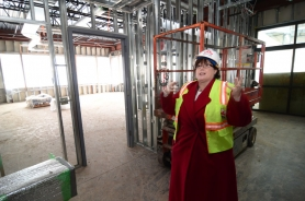 by: VERN UYETAKE Kim Calkins, OLL's director of development, stands next to the future art room, which will have great natural light from all the windows.