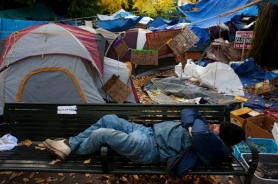 by: Christopher Onstott A homeless man slept on a city park bench this fall amid Occupy Portland tents in two downtown parks. Attorneys for four homeless people have reached a tentative settlement with the city in a federal lawsuit challenging Portland's anti-camping ordinance.