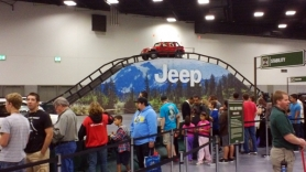 by: Courtesy of CHRYSLER CORP. Many visitors are expected to take the ride up and down the 18-foot-high indoor Jeep Mountain.