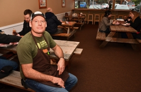 by: VERN UYETAKE Pine Shed Ribs' Matt Ramey shows off the establishment's new dining room. After a year in business, the eatery can now host parties, banquets and business gatherings.