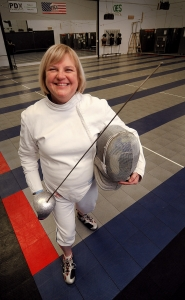 by: VERN UYETAKE Cheryl Maslen of Lake Oswego has taken on the challenges of aging by fencing her way to a silver medal at the 25th Oregon State Games of 2011.