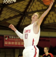 by: David Ball Mt. Hood center Spencer Clayton reaches high for a rebound during Saturday's win over SW Oregon.