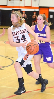 by: John Brewington DRIVING—Scappoose's Alix Raya makes a move to the basket during Friday's win over Astoria.