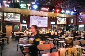 by: JIM CLARK Buffalo Wild Wings Bar and Grill in Wood Village is hosting a Super Bowl party with a $10 cover charge. The restaurant boasts 13 huge TVs and some prize drawings.