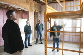 by: John Schrag Chris Higginbotham, Forest Grove High construction teacher, showed off the 2012 Viking House last Wednesday to developers who will build houses on adjacent lots as part of the Street of Affordable Dreams event in Forest Grove.