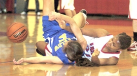 by: David Ball Centennial's Jazzy Taylor, right, goes to the floor with Barlow's Bethany Leliefeld in a fight for a loose ball Tuesday night.