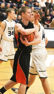 by: Chase Allgood GAME OVER–Scappoose's Joe Nelson corrals the ball at the conclusion of their game with Banks Friday.