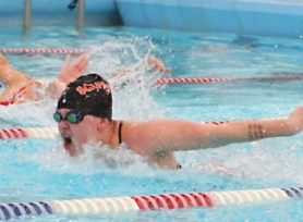 by: Kevin Alvrarez FLY FIRST—Scappoose's Erin Heath was first in the 100 butterfly, the 200 IM, and swam on two winning relay teams in last Tuesday's meet.