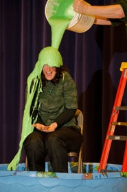 "by: Nick Fochtman Students laughed and cheered as Deer Creek Elementary School Principal Tiffany Wiencken was covered in ""slime"" Wednesday."