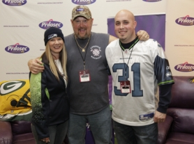 by: AJ MAST, A.P. Photographed before Super Bowl XLVI in Indianapolis, Ind., Larry the Cable Guy, center, creates a little attention for Rick Wenger of Sandy, the man who created the best tailgating setup in the NFL. At left is Wenger's friend, Shirley Hamry of Sandy.