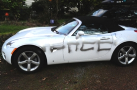 by: SUBMITTED PHOTO Here's one of the vehicles in Lake Oswego that was damaged Sunday night by vandals. Two teens were arrested Monday. Photo by Mark Kronquist