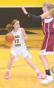 by: John Brewington  WHERE TO GO?—St. Helens' Michelle Sass looks to pass during last week's game with Milwaukie