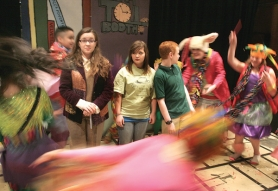 by: Jim Clark Katy Petersen as The Humbug, from left, Shailee Clark as Tock the Watchdog and Ben Morris as Milo are confronted by demons in Reynolds Middle School's production of 'The Phantom Tollbooth.'