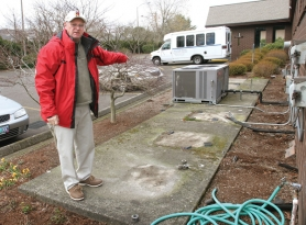 by: Jim Clark Len Lukens, head trustee for Rivercrest Community Church, shows where heating and air conditioning units were stolen on Monday night. The thieves stole five units from this platform and two others located at the rear of the church.