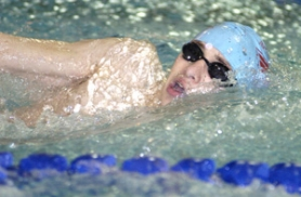 by: David Ball Centennial's Brandon Catabay takes a breath in the backstroke during the dual season.