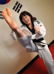 by: VERN UYETAKE Jordan shows off some of her athleticism as a black belt in the martial arts.