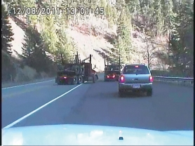 by: Clackamas County Sheriff This photo was taken from the dashboard of the second deputy, who arrived minutes before the suspect's car was run off the road.