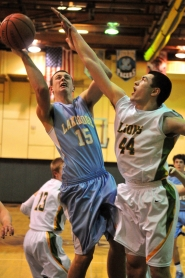 by: VERN UYETAKE Brandon Loiler puts up a shot against West Linn's Ryan Shearmire in Tuesday's loss to the Lions.