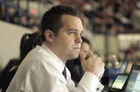 by: David Ball Winterhawks assistant coach Kyle Gustafson, in his eighth season with the team, keeps an eye on the action during a recent game against the      Vancouver Giants.