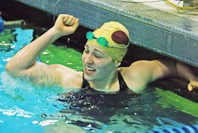 by: Dan Brood Forest Grove junior Vera Hutchison celebrates after winning the 200-yard individual medley at Saturday's Pacific Conference district swim meet. Hutchison was seeded fourth in the event going into the finals, but swam to 