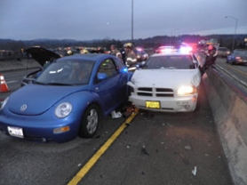 by: Submitted Photo Early Feb. 16, a Clackamas County Sheriff's Office deputy collided into the back of a passenger car after also hitting the center concrete barrier on the Abernethy Bridge. After impact, the passenger car and deputy's car collided with a stopped Volkswagen Bug in the left southbound lane.