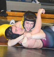 by: John Brewington SECOND PLACE—St. Helens' Andrew Duggan was second in district at 120 pounds to earn a state tourney berth.