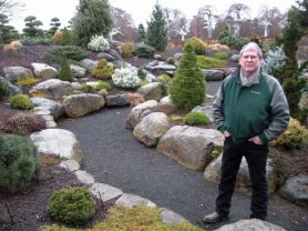 by: Jim Hart Jock Demme of Iseli Nursery in Boring stands in the midst of a three-acre demonstration garden, showing how some dwarf or slow-growing conifers and other perennials can make an attractive year-round plant display — especially good for small yards or patios.