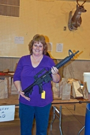 by: Courtesy photo ARMED TO THE TEETH — Chris Underwood of St. Helens sports a Mossberg .22 she won at the grab bag event at the 7th Annual Columbia County Chapter of the Oregon Hunters Association annual banquet.