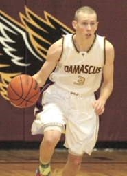 by: David Ball Damascus Christian senior Eric Rauch turns upcourt during Wednesday's playoff loss to Ione. He hit four 3-pointers on the night and led the Eagles with 16 points.