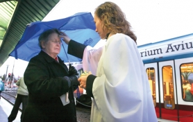 by: JIM CLARK The Rev. Jennifer Creswell of St. Luke Episcopal Church offers blessings and ashes to the community at the MAX station next to Gresham City Hall on Ash Wednesday, Feb. 22. Here she blesses Ann Muir.