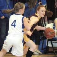 by: David Ball Damascus Christian's Karissa Cox drives past a St. Paul defender Friday night.