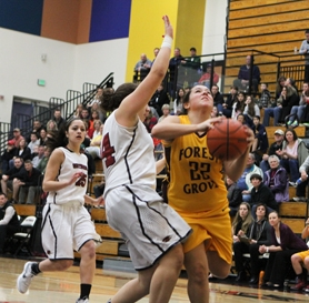 by: Chase Allgood Forest Grove senior Taylor Lira (22) takes the ball to the basket during last Friday's state play-in game against Southridge. The Lady Viks lost the game 64-33.