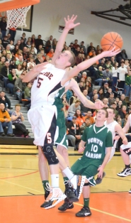 by: John Brewington UNSTOPPABLE—Scappoose's Blake Updike had another big game Saturday, helping the Indians advance to the playoffs with a win over North Marion.
