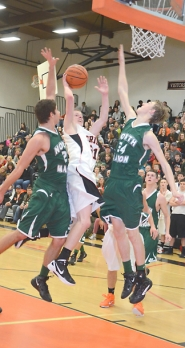 by: John Brewington PLAYING BIG—Scappoose's Joe Nelson came up huge during the Indians' play-in win over North Marion.
